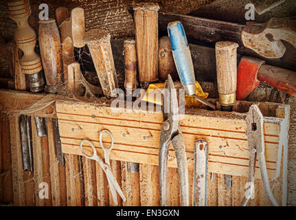 Retro filtered background made of old rusty woodworking tools. - Stock Photo