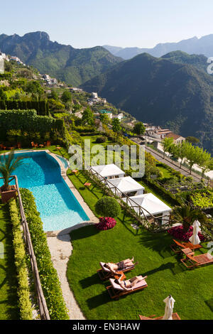 Italy, Ravello, Terrace with outdoor pool on hill - Stock Photo