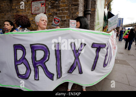 Protesters form a human chain around the Railway Arches in Brixton to protest against evictions. - Stock Photo