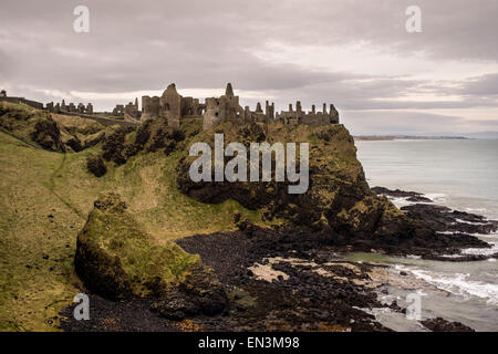 A view on an overcast day of Dunluce medieval castle, County Antrim in Northern Ireland  Credit: Euan Cherry - Stock Photo