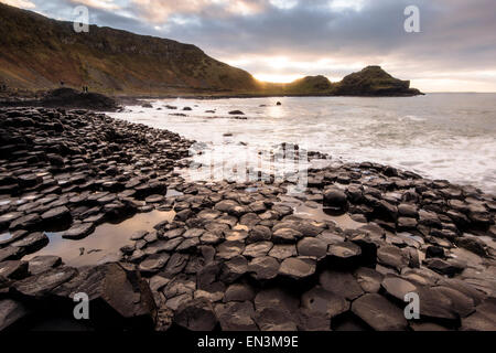 Sunset over Giant's causeway in County Antrim on the northeast coast of Northern Ireland.  Credit: Euan Cherry - Stock Photo