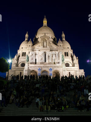 France, Paris, Montmartre, Sacre Coeur with tourists on steps - Stock Photo
