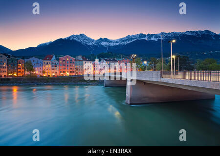 Innsbruck. Image of Innsbruck, Austria during twilight blue hour with European Alps in the background. - Stock Photo