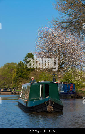 A canal boat on the Trent and Mersey canal at Fradley Junction, Staffordshire, England. - Stock Photo