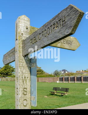 Wooden public footpath fingerpost on a summers day in West Sussex, England, UK. - Stock Photo