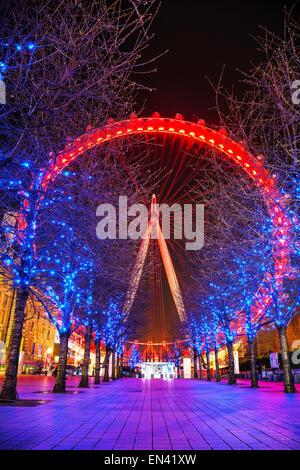 LONDON - APRIL 5: The London Eye Ferris wheel in the evening on April 5, 2015 in London, UK. - Stock Photo