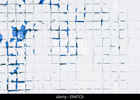 Peeling paint on a wall of tiles as a background image - Stock Photo
