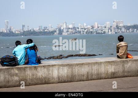 Mumbai India Asian Churchgate Marine Drive Back Bay Arabian Sea teen boy girl couple romantic Malabar Hill skyline - Stock Photo