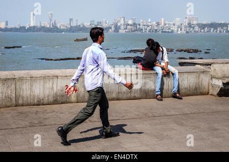 Mumbai India Asian Churchgate Marine Drive Back Bay Arabian Sea man woman couple romantic Malabar Hill skyline pedestrian - Stock Photo