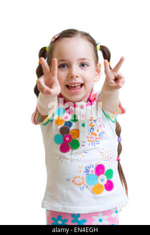 Child girl showing victory hand sign on white background - Stock Photo