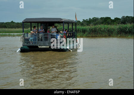 St Lucia, KwaZulu-Natal, South Africa, group of adults and children on boat cruise, viewing wildlife in estuary, - Stock Photo