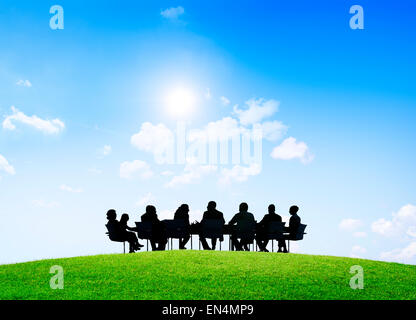 Group of business people having an outdoor meeting. - Stock Photo