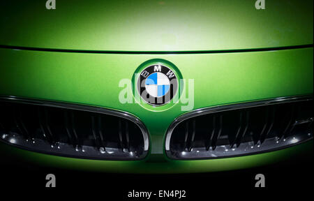BMW logo emblem on a green car. Shot taken on a car exhibition. Editorial use only - Stock Photo