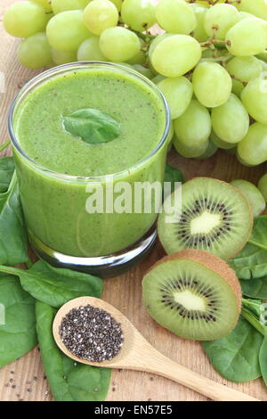 Green smoothie rich in dietary fiber : spinach, chia seeds, grapes and kiwi. - Stock Photo