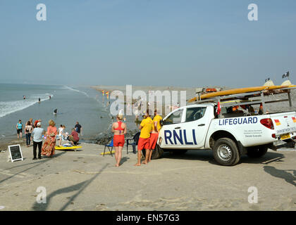 The RNLI lifeguards keep a watchful eye on the bathers and surfers on Westward Ho! North Devon at high tide - Stock Photo
