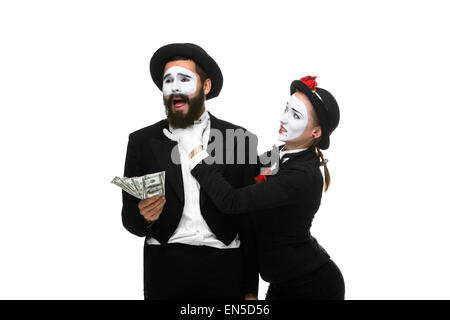 memes as businesswoman and businessman counting money - Stock Photo