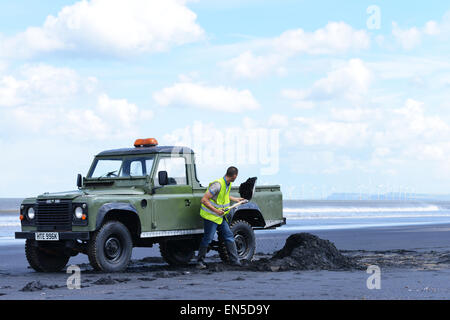 Hartlepool, Cleveland, UK. 28th April 2015. Tony Reid, 22, from Hartlepool forages for Sea-coal that is washed up - Stock Photo