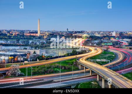 Washington, DC skyline of monuments and highways. - Stock Photo