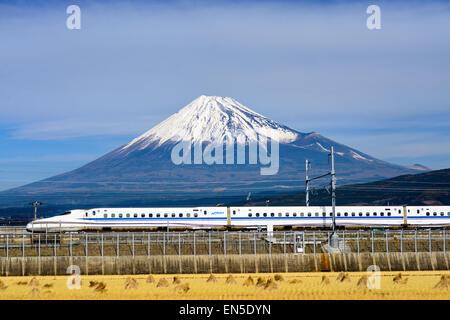 A Shinkansen bullet train passes below Mt. Fuji in Japan.