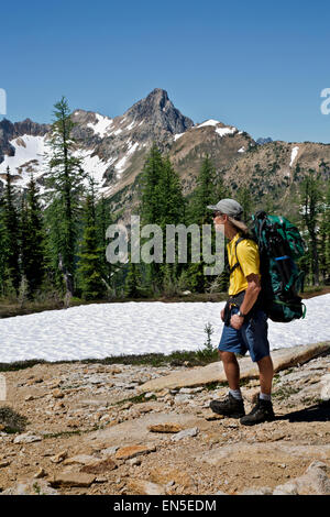WASHINGTON - Hiker on the Pacific Crest Trail at Cutthroat Pass in the North Cascades section of the Okanogan National - Stock Photo