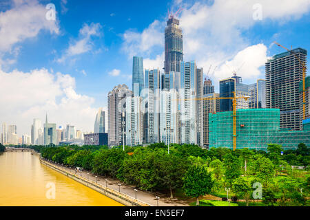 Guangzhou, China modern office building construction on the Pearl River. - Stock Photo