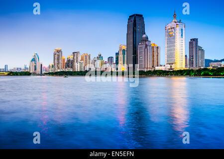 Xiamen, China skyline on Yundang Lake at twilight. - Stock Photo