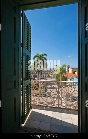 Vertical view through a window of Plaza Mayor in Trinidad, Cuba. - Stock Photo