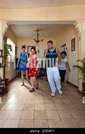 Vertical view of a group of tourists having a salsa lesson in Trinidad, Cuba. - Stock Photo