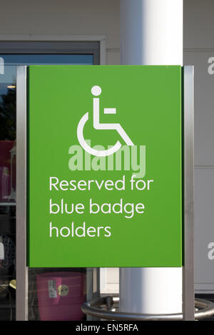 Disabled parking bay sign for blue badge holders - Stock Photo