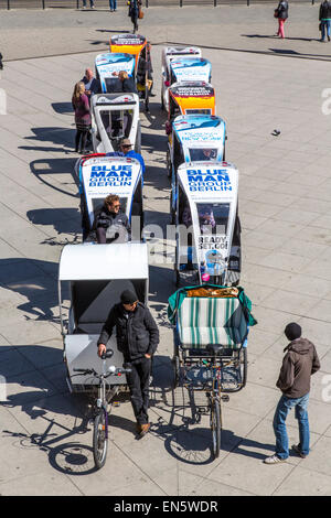 Bicycle Rickshaw drivers wait for customers, for city tour sightseeing, Alexander Square, - Stock Photo