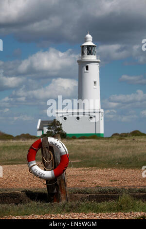 Hurst Ferry life ring with Hurst Point Lighthouse in the background at Hurst Spit Keyhaven, New Forest, Hampshire, - Stock Photo