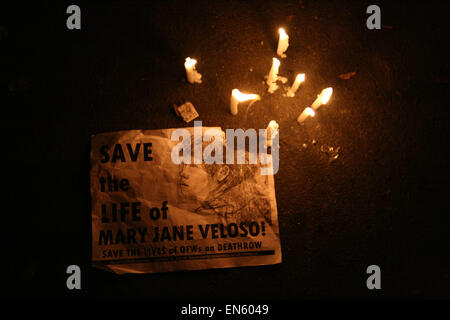 Makati, Philippines. 28th Apr, 2015. A poster and candles protesting the impending exection of Mary Jane Veloso. - Stock Photo