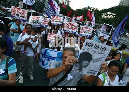 Makati, Philippines. 28th Apr, 2015. Protesters start their march towards the Indonesian embassy in the heart of - Stock Photo