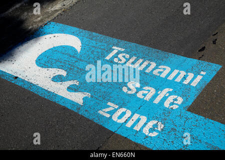 Tsunami safe zone sign, Wellington, North Island, New Zealand - Stock Photo