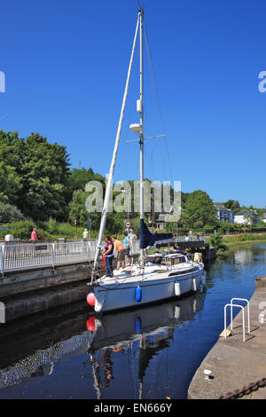 Yacht approaching a lock on the Crinan Canal at Ardrishaig in Argyll, Scotland - Stock Photo