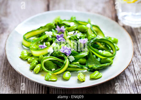 Asparagus, broad beans and lilac salad - Stock Photo