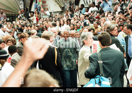 South African President Nelson Mandela seen here visiting Brixton Market with Prince Charles during the Presidents - Stock Photo