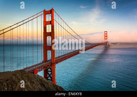 Sunset view of the Golden Gate Bridge and fog from Battery Spencer,  Golden Gate National Recreation Area, in San - Stock Photo