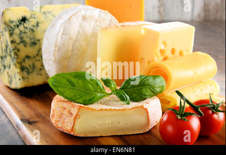 Different sorts of cheese isolated on kitchen table. - Stock Photo