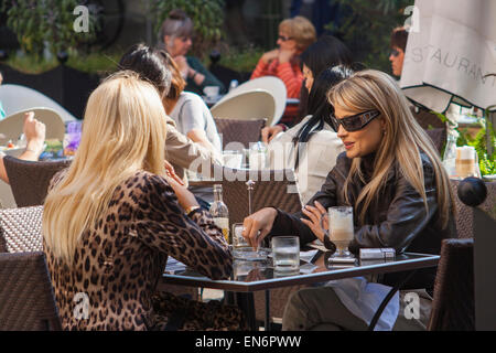Stylish young women at a cafe in Pest, Budapest, Hungary - Stock Photo