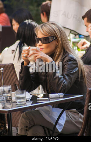Stylish young woman at a cafe in Pest, Budapest, Hungary - Stock Photo