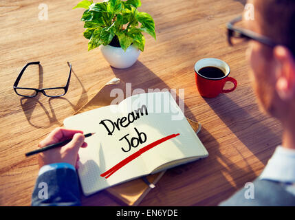 Businessman with Note About Dream Job Concepts - Stock Photo