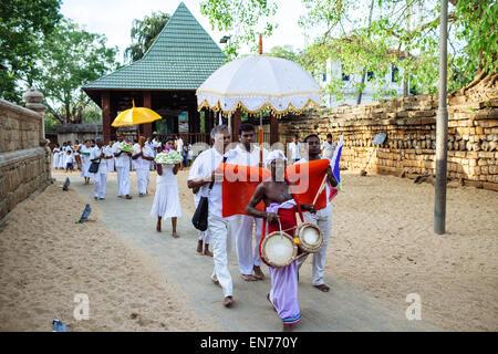 Pilgrims bring offerings to Sri Maha Bodhi in Anuradhapura, Sri Lanka. - Stock Photo