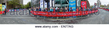 Panorama of the corner of Tower Bridge Road and East Smithfield on the day of the London Marathon 2015 - Stock Photo