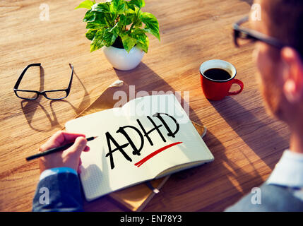 Business Man with Notepad and ADHD Concepts - Stock Photo