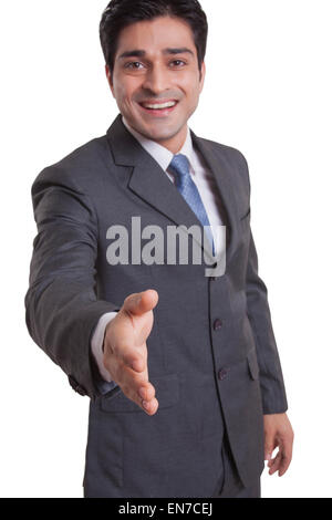 Portrait of a businessman extending a hand to shake - Stock Photo