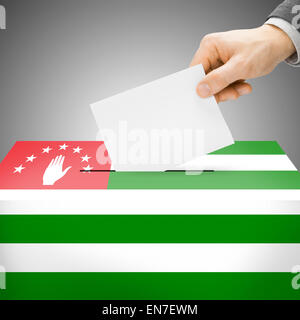 Ballot box painted into national flag colors - Abkhazia - Stock Photo