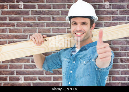 Composite image of confident carpenter carrying wooden plank - Stock Photo