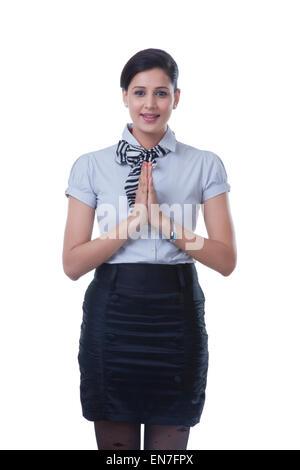 Portrait of air hostess greeting - Stock Photo