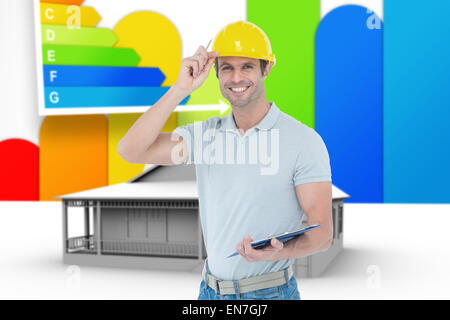 Composite image of architect wearing hard hat while holding clip board - Stock Photo
